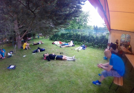 Runners recuperate in the mid-afternoon sun