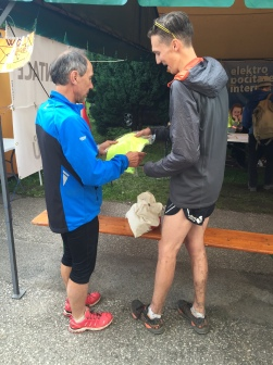 Collecting prizes from the race director. Photo courtesy of Lukas Svoboda